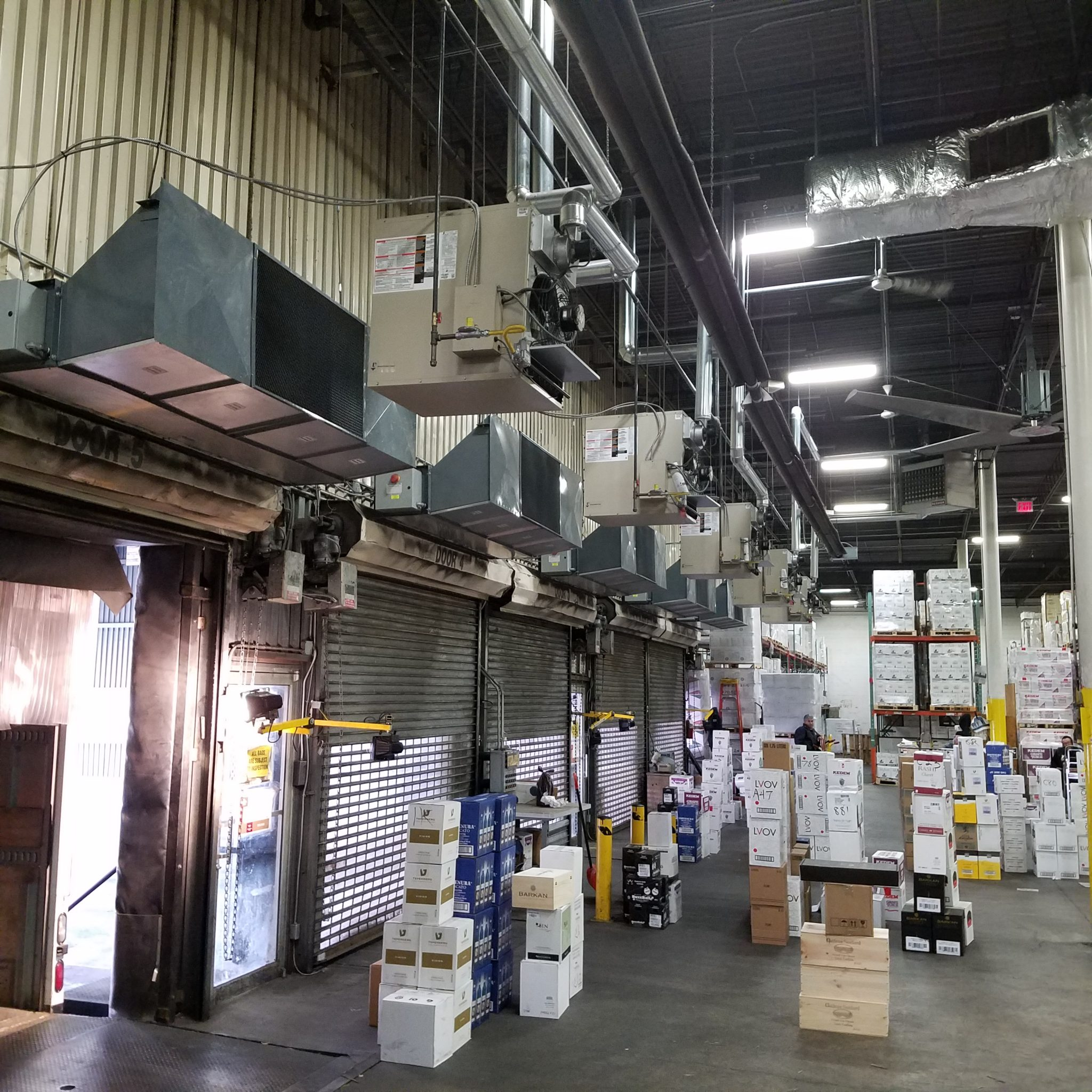 5 Berner Industrial Direct Drive Air Curtains over shipping receiving doors at Royal Wine